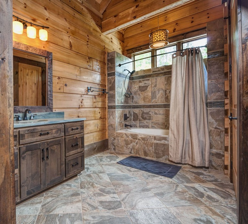 Bathroom With Tles And Rustic Cabinets
