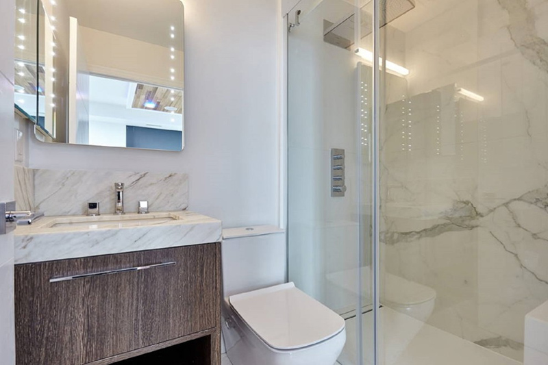 Condo Bathroom With Contemporary Mirror