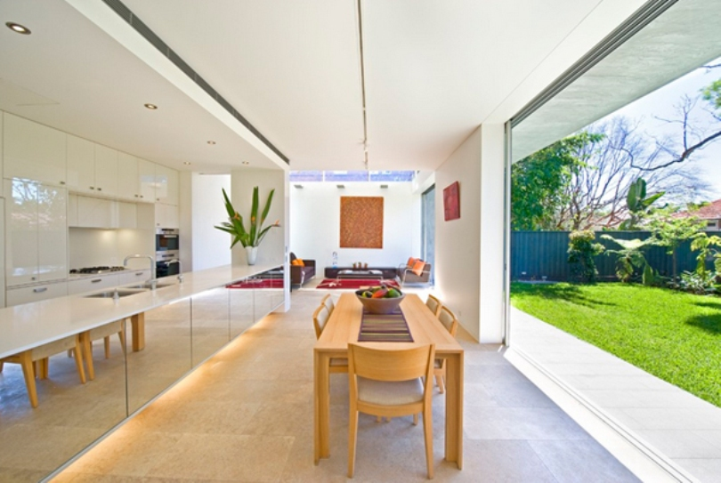 Kitchen And Dining Area With Mirrored Furniture