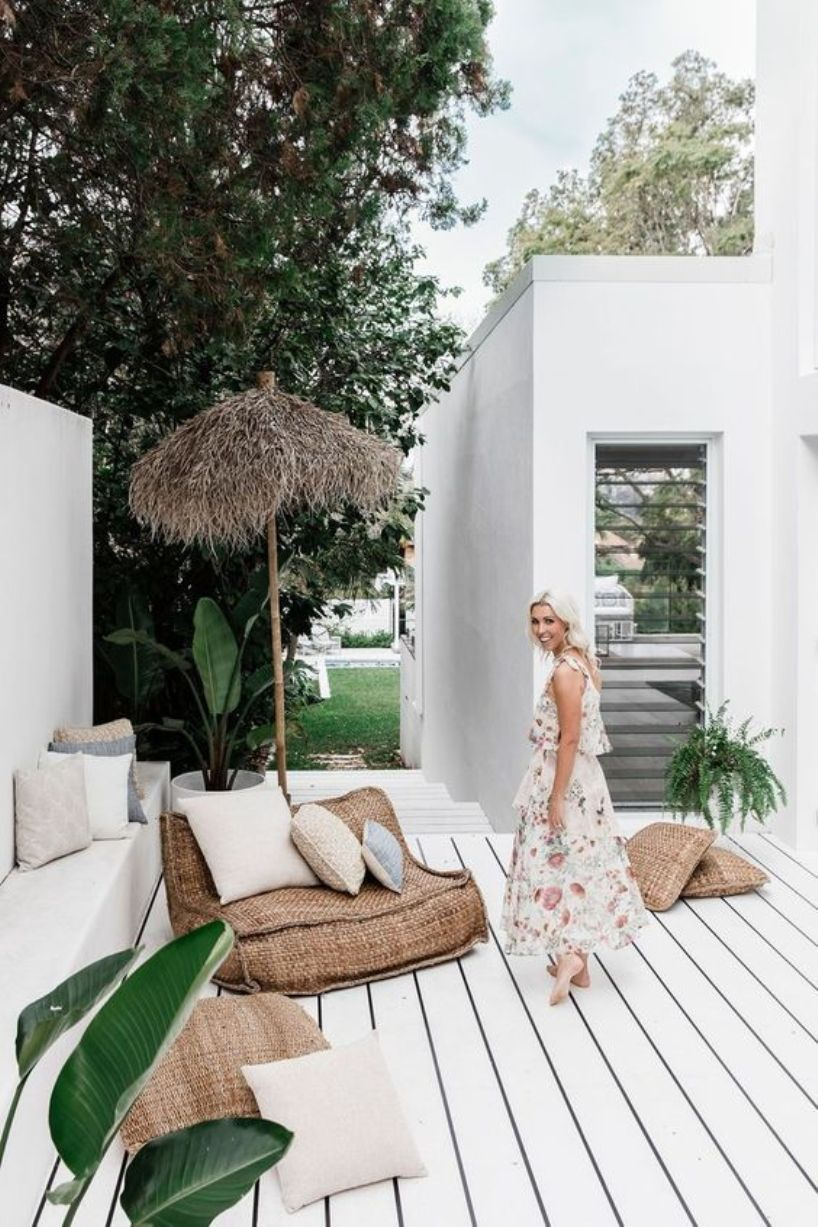 Tropical Porch With A Whitewashed Wooden Floor